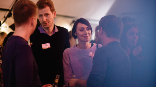 Members of the Factory Berlin community networking and in discussion at an event.