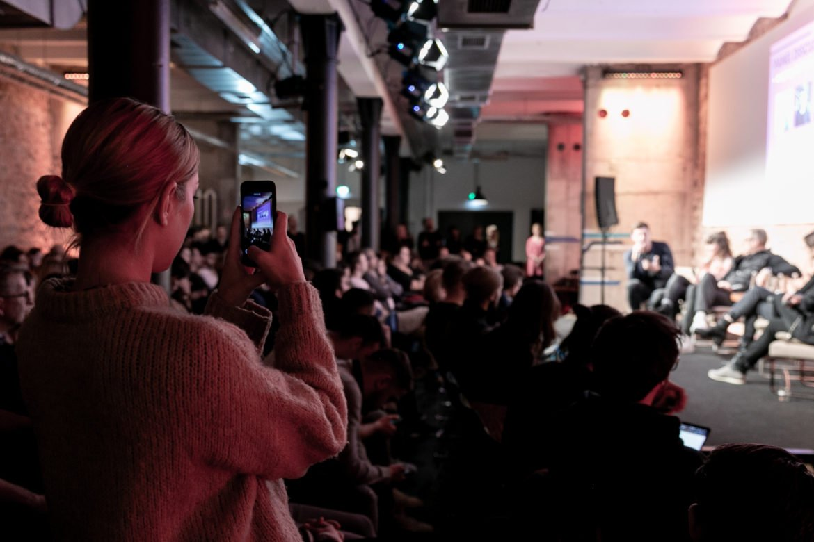 A photo of someone livestreaming a Factory Berlin Fireside Chat online.