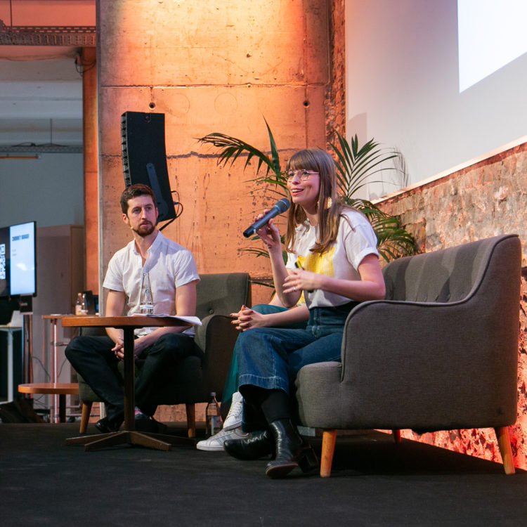 A member of the Factory Berlin answering questions on stage.