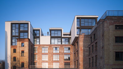 An exterior photo of Factory Berlin Mitte, which has community space, startup labs and event spaces.