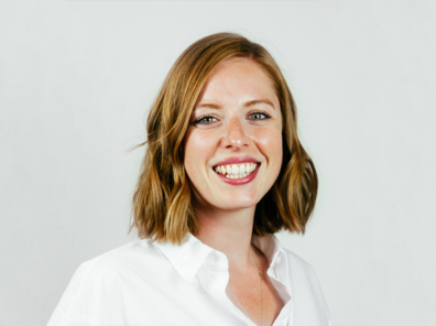 A photo of Tinia Mühlfenzl, Director of Market Development at TIER Mobility