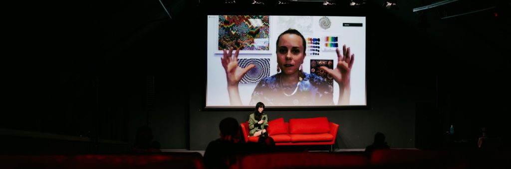 A photo of Jen Stark and Tabitha Swanson at On The Red Couch virtual hybrid event.